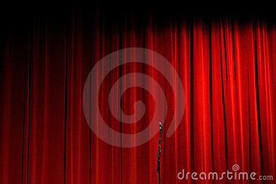 Red Curtain on Stage With Microphone