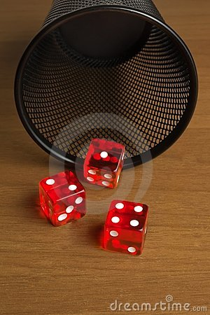 Red dice  near a container