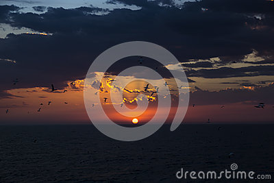 Red disk of the sun. Sea sunset. Stock Photo