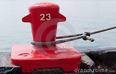 Red Dock cleat securing a ship