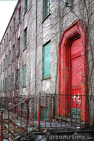 Red door of abandoned building