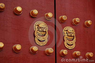 Red door with golden lion handle