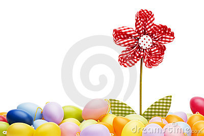 Red drapery flower between easter eggs