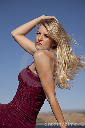 Red dress sit hand in hair