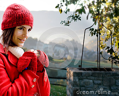 Red dressed girl against Tuscany landscape
