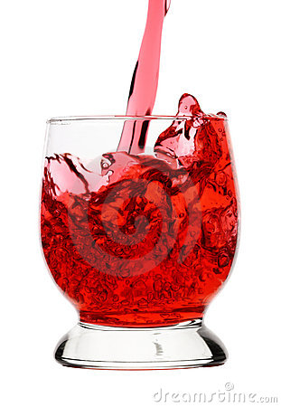 Red drink (wine) is being poured into glass