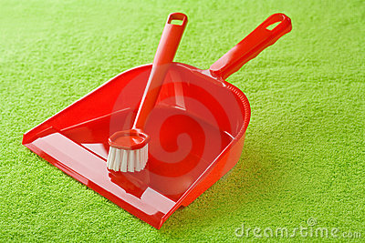 Red dustpan with brush