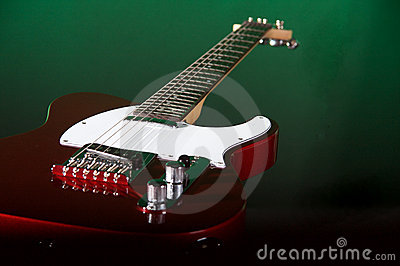 Red Electric Guitar On Green