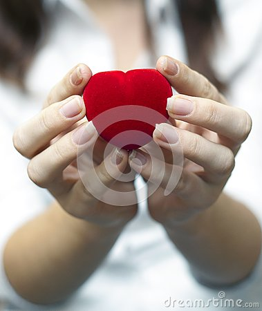 Red engagement box holding by hand of young girl