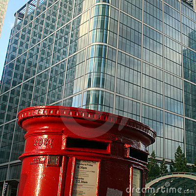 Red English postbox on architectural background