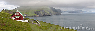 Red farmhouse on coast of Mykines
