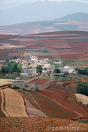 Red farmland with village in dongchuan of china