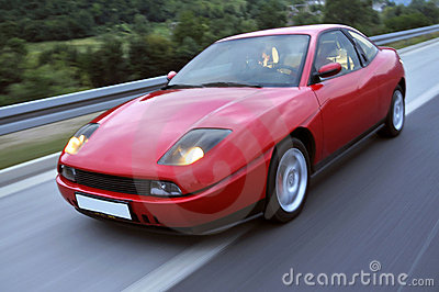 Red fast racing car onthe highway