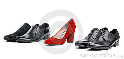 Red female shoe between black male shoes in range