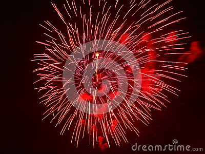 Red fireworks in night sky