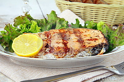 Red fish salmon grilled with lemon