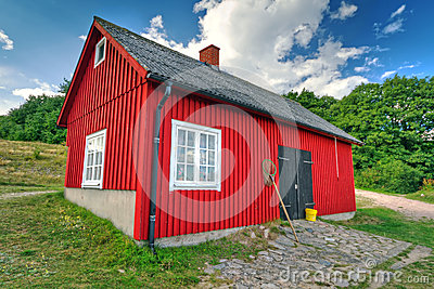 Red fisherman house on the coast of Sweden