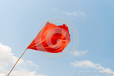 Red flag on the beach. Warning about the dangers