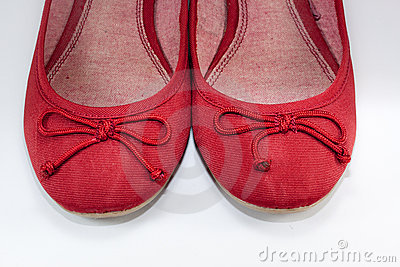 A pair of red flat shoes over white background