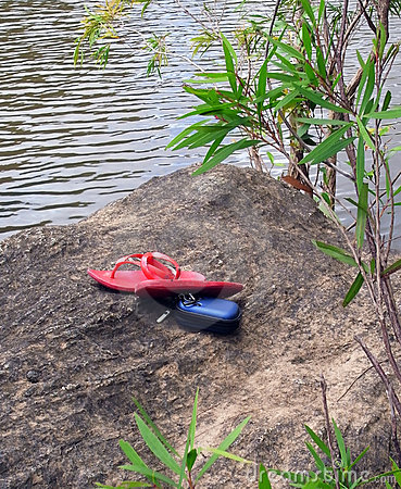 Red flip flops, blue camera case