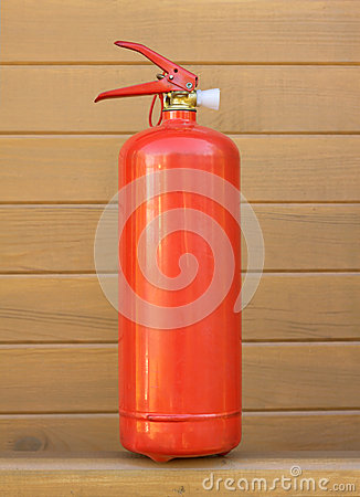 Red foam extinguisher over brown wall