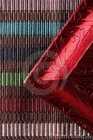 Red frame corner over multi color tablecloth