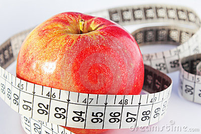Red fresh apple and measure tape. diet concept