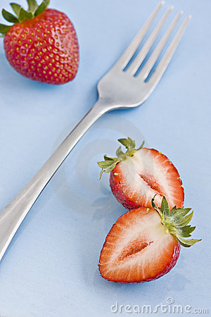 Red fresh strawberries and a fork
