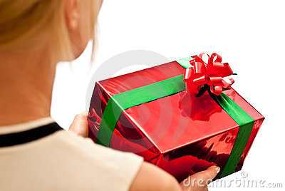 Red gift box in hands
