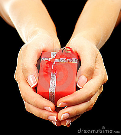 Red gift box with hands