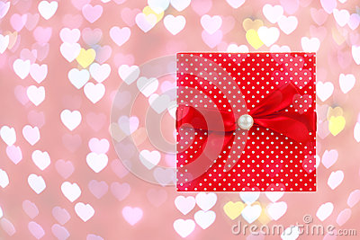 Red gift box on heart bokeh