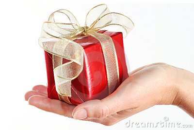 Red gift box in woman s hand