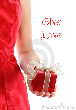 Red gift box in woman s hands