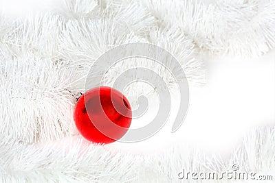 Red glass ball and Christmas tinsel