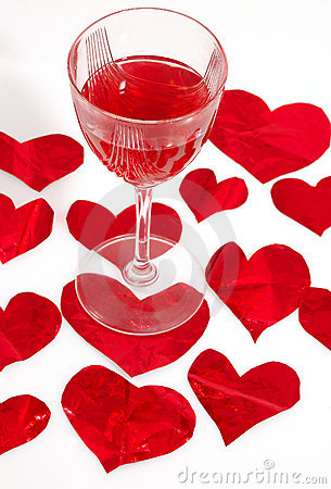 Red glass of wine and red hearts