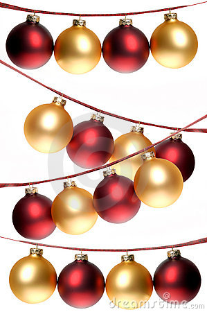 Red and gold Christmas ornaments strung in rows, on plaid ribbon