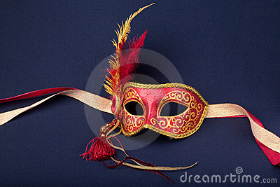 Red and gold feathered mask