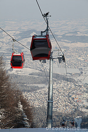 Red gondola in air