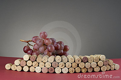 Red grape and group of wine corks