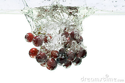 Red Grapes Splashing Into Water