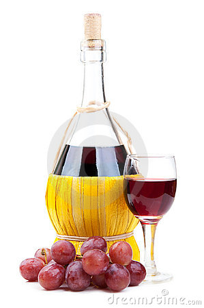 Red grapes and wine bottle