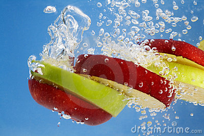Red and Green apple slices underwater