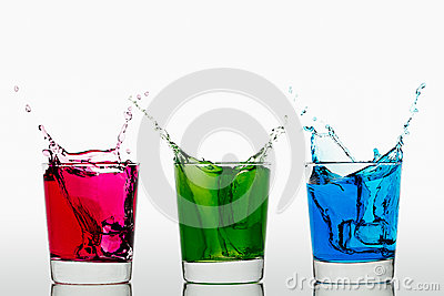 Red Green Blue splashing ice cubes