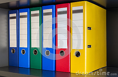 Red, green, blue and yellow office folders