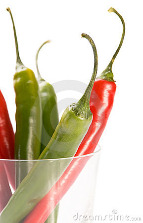 Red and green  chilly peppers in glass