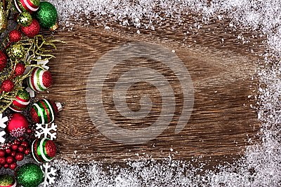 Red, green and white Christmas ornament side border on wood Stock Photo