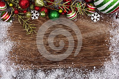 Red, green and white Christmas ornament top border on wood Stock Photo