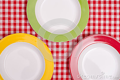Red, green and yellow plate on a cloth