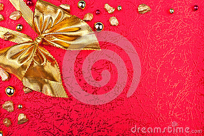 Red greeting card with golden ribbon