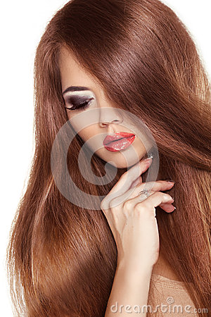Red Hair. Beauty Woman with Very Long Healthy and Shiny Smooth B